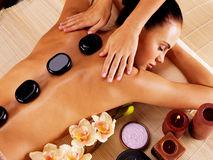 adult-woman-having-hot-stone-massage-spa-salon-beauty-treatment-concept-61900404